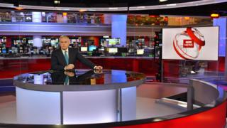 Huw Edwards in the BBC newsroom studio