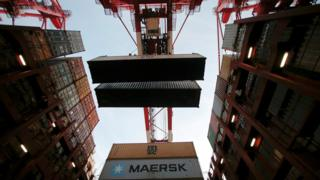 Containers being unloaded
