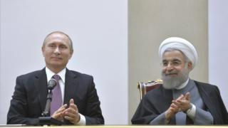 Russian President Vladimir Putin and his Iranian counterpart Hassan Rouhani attend a news conference in Tehran