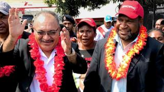 "In this handout photo taken on July 16, 2017 shows then Papua New Guinea prime minister Peter O""Neill (L) and then finance minister James Marape (R)"