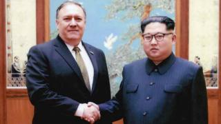 Mike Pompeo (L) shakes hands with North Korean leader Kim Jong-un in Pyongyang, North Korea