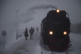 A steam train of the Harzer Schmalspurbahn narrow-gauge railway arrives at the Brocken station in Wernigerode, eastern Germany.