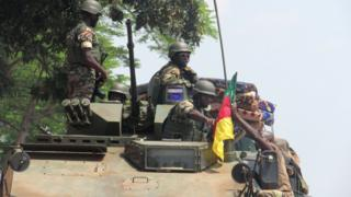 Cameroonian military on top tanker.
