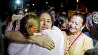 Maria Perez hugs her family after her release