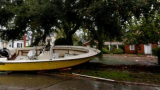 Boats pushed away from the dock on a street in the town of New Bern, North Carolina on 14 September 2018.