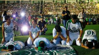 Fans of Chapecoense soccer team pay tribute to the players at the Arena Conda stadium in Chapeco, Brazil