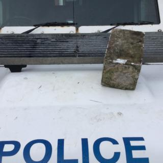 Stone thrown at police