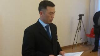 Jo Song-gil reads report at embassy reception in Rome in April 2018