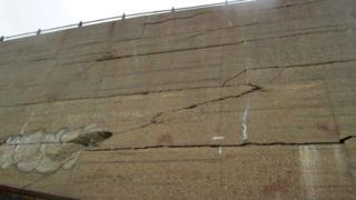 Cracks in the sea wall at Folkestone