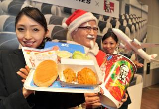 Japan Airlines shows off a plate of 'AIR Kentucky Fried Chicken