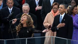 Beyonce performs the national anthem as U.S. President Barack Obama looks on during the presidential inauguration on the West Front of the U.S. Capitol January 21, 2013 in Washington, DC.