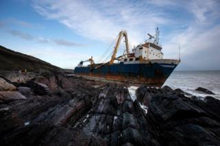 A view of the abandoned ghost ship Alta stuck on the rocks of the Irish coast