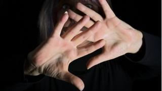 Generic image of someone holding hands up in a defensive move