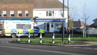 Police van in front of shops