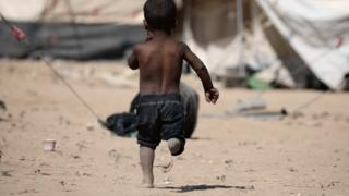 Syrian boy in refugee camp