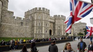 Tourists outside Windsor Castle, where Prince Harry and Meghan Markle will marry on 19 May