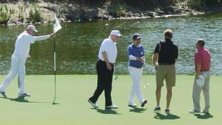US President Donald Trump (2nd L) and Japan's Prime Minister Shinzo Abe (C) enjoy playing golf in Florida.