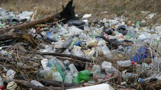 Piles of washed-up plastic bottles littered the River Rhymney before the clean-up in March