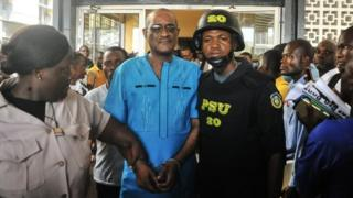 Charles Sirleaf (centre) is escorted outside from a court in Monrovia, Liberia. Photo: 4 March 2019