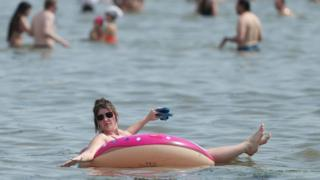 People enjoy the hot weather at Southend beach in Essex. 8 August 2020