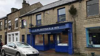 Outside shot of J W Mettrick & Son butchers' shop