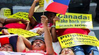 Environmental activists protest outside the Canadian embassy in Manila on May 21, 2019, to push the government of Canada to speed up removal of their garbage out of Manila and Subic Ports.