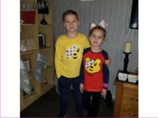 image of boy and girls in Children in need dress up