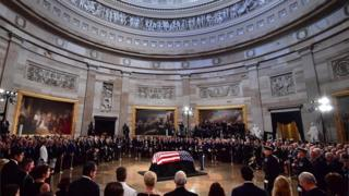 Former Senator John McCain lies in state in the Capitol Rotunda at the US Capitol in Washington DC on 31 August 2018