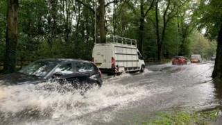 cars navigate localised floods in Leicester