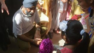 Canada's Defence Minister Harjit Singh Sajjan (C) talk with children during his visit to the All India Pingalwara Charitable Society (AIPCS) at Manawala village on the outskirts of Amritsar on April 20, 2017.