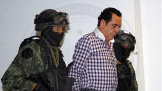 Soldiers escort head of the Beltran Leyva drug cartel Hector Beltran Leyva in Mexico City, in this handout picture taken October 1, 2014