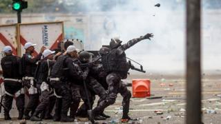 Football Riot police disperse fans of Flamengo football club taking part in a celebration parade