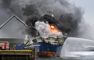 The Russian fishing trawler Bukhta Nayezdnik burns in the harbour of Tromso, northern Norway, 25 September 2019 (issued 26 September 2019).