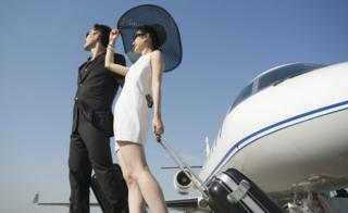 rich couple with private jet