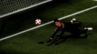Thibaut Courtois makes a save