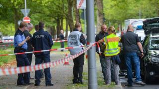 Police investigators secure the scene where officers shot dead an Islamist knifeman