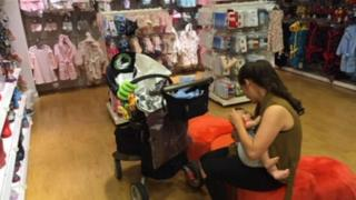 Zoe Frangou in Mothercare with her baby