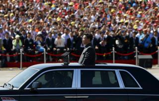 Chinese President Xi Jinping stands in a car on his way to review the army, at the beginning of the military parade marking the 70th anniversary of the end of World War Two, in Beijing, China, 3 September 2015