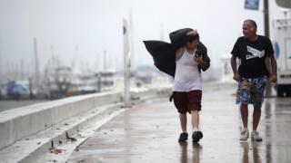 People walk through high winds in Corpus Christi