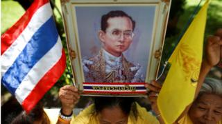 "Well-wishers hold a picture of Thailand""s King Bhumibol Adulyadej at the Siriraj hospital where he is residing, in Bangkok, Thailand, June 9, 2016."