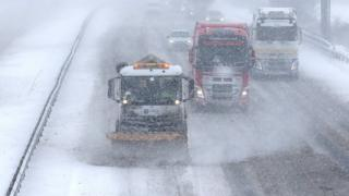 Snow plough clearing a motorway