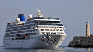 A cruise liner is hauled into port in Cuba