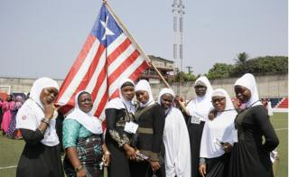 Liberian Muslim women poses with the Liberian flag during observance of World Hijab Day in Monrovia, Liberia, 01 February 2019.