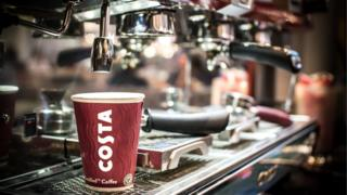 Costa Coffee cup on coffee machine