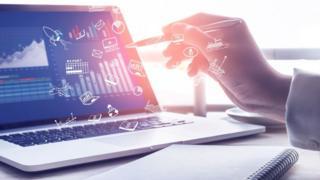 A businessman at a computer