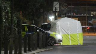 A police car and tent on Battersea Church Street