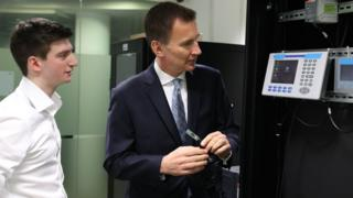 "Jeremy Hunt creates a ""cyber attack"" during a visit at the University of Glasgow."