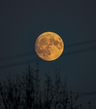 Moonrise over Milcombe on a late afternoon