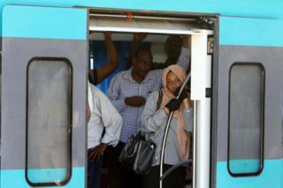 in_pictures Passengers ride on board a train in Khartoum, Sudan - Tuesday 26 November 2019