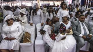 Mourners of preacher Elisabeth Wosho Onyumbe dressed in white at her funeral in Kinshasa, DR Congo - Saturday 23 June 2018